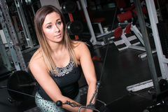 Woman exercising using a cable machine Stock Photo