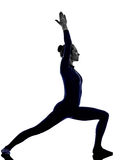 Woman exercising Virbhadrasana I warrior pose yoga silhouette Stock Photos