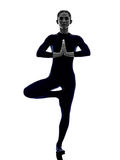 Woman exercising Vrksasana tree pose yoga silhouette Stock Photography
