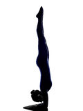 Woman exercising vrschikasana scorpion pose yoga silhouette Royalty Free Stock Photography