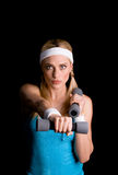 Woman exercising with weights Royalty Free Stock Image
