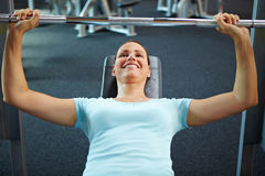 Woman exercising with weights Royalty Free Stock Photos