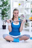 Woman exercising with weights Royalty Free Stock Photo
