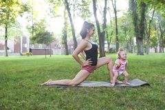 Woman Exercising With Her Baby Girl In The Park Royalty Free Stock Photo