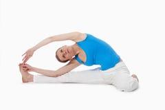 Woman exercising yoga Royalty Free Stock Photos