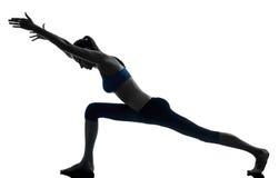 Woman exercising yoga stock photography