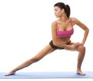 Woman exercising yoga Stock Photos