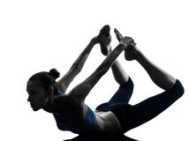 Woman exercising yoga bow pose Stock Photography