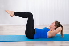 Woman Exercising In Yoga Class Royalty Free Stock Photography