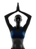 Woman exercising yoga hands joined portrait Royalty Free Stock Image
