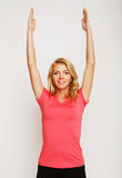 Woman exercising yoga with her arms over her head Royalty Free Stock Photos