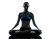 Woman exercising yoga meditating silhouette Stock Images