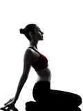 Woman exercising yoga meditation silhouette Royalty Free Stock Images