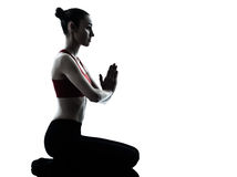 Woman exercising yoga meditation silhouette Royalty Free Stock Photos