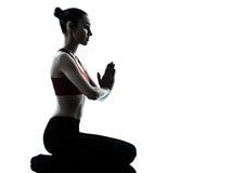 Woman exercising yoga meditation silhouette Royalty Free Stock Photos