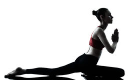 Woman exercising yoga Royalty Free Stock Images