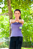 Woman exercising yoga in park Stock Image