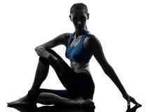 Woman exercising yoga sitting stretching Royalty Free Stock Images