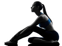 Woman exercising yoga sitting stretching Royalty Free Stock Image