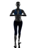 Woman exercising yoga warrior position Stock Photography