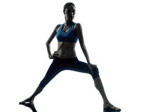 Woman exercising yoga warrior position Royalty Free Stock Photo