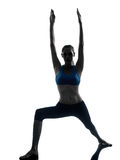 Woman exercising yoga warrior position silhouette Stock Image