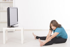Woman exercisng at home Stock Photo