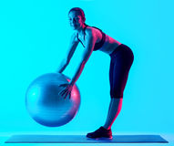 Woman exercsing fitness pilates exercices isolated Royalty Free Stock Image