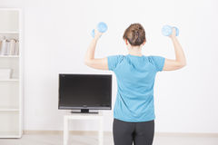 Woman exericisng at home Stock Image