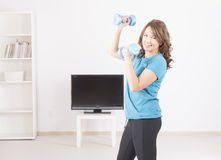 Woman exericisng at home Royalty Free Stock Images