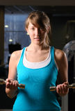 Woman is exersising in gym Royalty Free Stock Image
