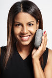 Woman Exfoliating concept. Black woman making exfoliating with a sponge Royalty Free Stock Photos