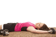 Woman exhausted weights Royalty Free Stock Photography