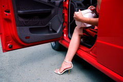 Woman exiting car Royalty Free Stock Photography