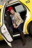 Attractive Woman Traveler exits a Taxi Cab Royalty Free Stock Image