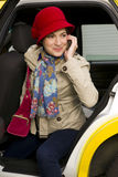 Attractive Business On Phone Woman exits a Taxi Stock Images