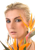 Woman with exotic flower Royalty Free Stock Images
