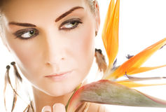 Woman with exotic flower Royalty Free Stock Photo