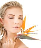Woman with exotic flower Stock Images