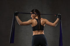 Woman with expander exercising in gym Stock Photos