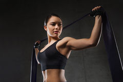 Woman with expander exercising in gym Royalty Free Stock Photos