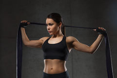Woman with expander exercising in gym Stock Images