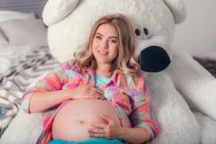 Woman expecting a baby stock photography