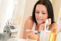 Woman expecting pregnancy test result in bathroom Stock Image