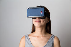 Woman experience though virtual reality device stock image