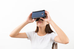 Woman experience though the visual reality device Royalty Free Stock Photo