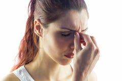 Woman experiencing headache Stock Image