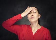 Woman experiencing a headache. Stock Photos