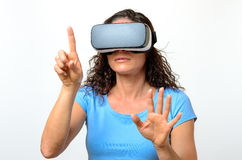 Woman experiencing a virtual environment Royalty Free Stock Image