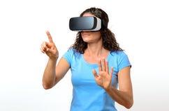 Woman experiencing a virtual environment Stock Photo